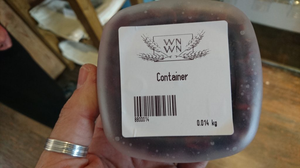 Barcode attached to container